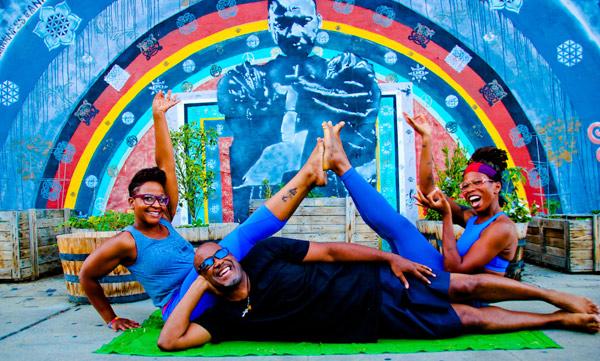 3 people doing yoga