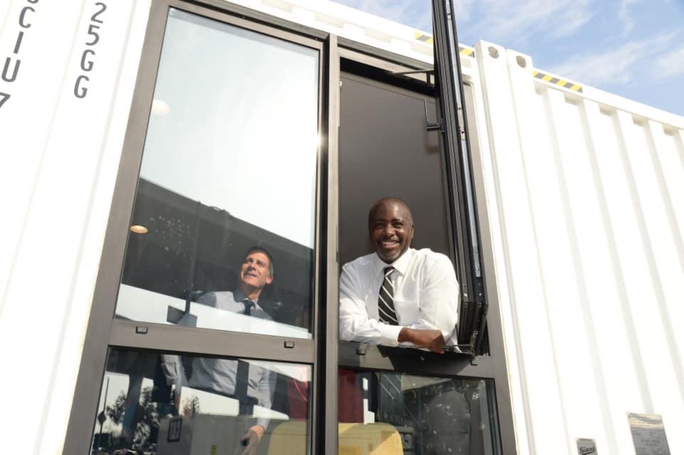 Marqueece Harris Dawson in container home window